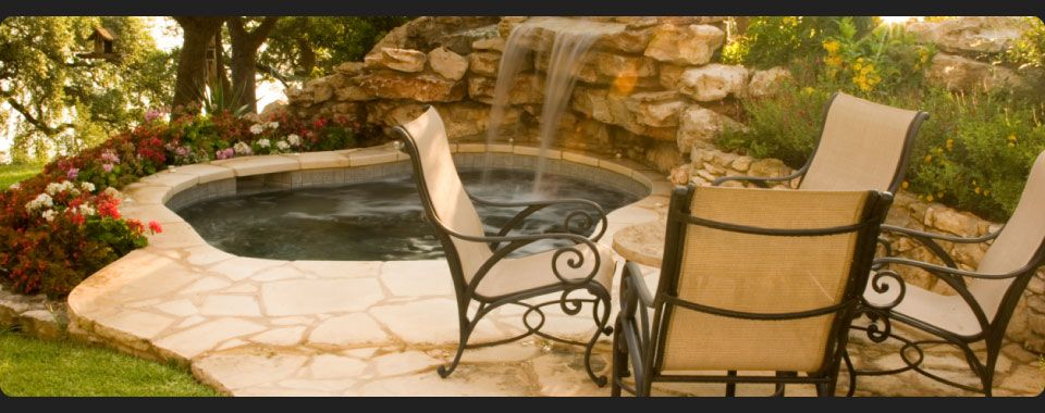 Backyard with stone fountain and small pool